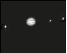 Jupiter with three moons, photographed by a beginner's telescope